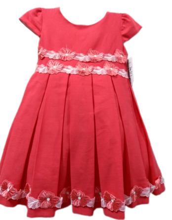 Vestido de niña con flores bordadas