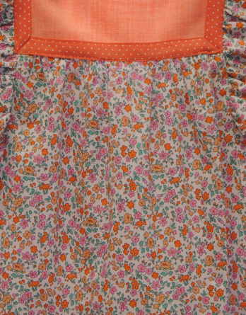 Vestido de niña con flores naranjas